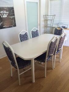 White table and six chairs available