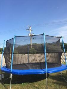Barely Used 14ft Trampoline with Safety Net Bought Over $400