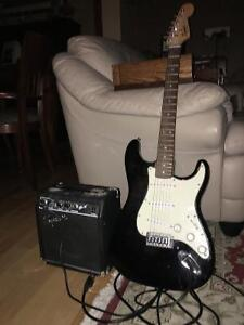 Squier Fender strat electric guitar, amp and cords