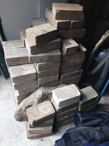 Assorted interlocking pavers and bricks