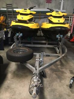 Two Seadoo Jet Skis including Tandem Trailer