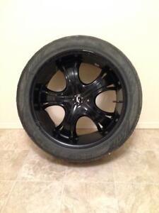 "Gloss Black rims 22"" on Toyo tires 6x137.9 bolt pattern"