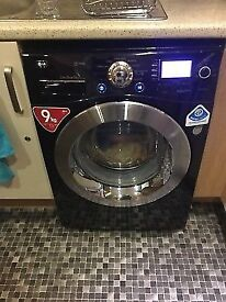 LG A+++ class 9kg direct drive washing machine black and chrome