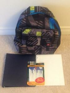 "Backpack with package of 11 pens, 1"" binder and lined paper"