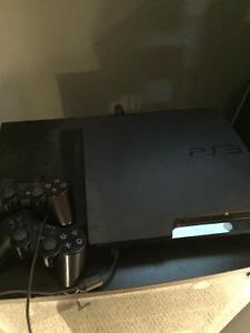 PS3 console with contollers