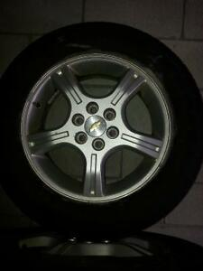 GM FACTORY RIMS WITH TIRES