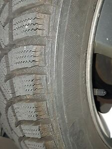 "Kia Wheels almost new 205 55 16 tires with original 16"" Mags"