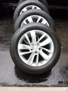 BUICK REGAL 18 INCH FACTORY OEM ALLOY WHEELS WITH HIGH PERFORMANCE 245 / 55 / 18 ALL SEASON TIRES.