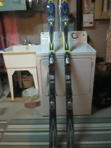 Skis, poles, boots and goggles