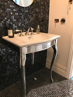 Sink and taps on steel cabriole legs