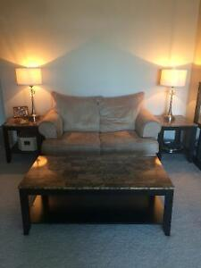 Tan microfibre love seat with coffee table and two end tables