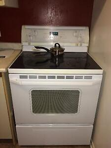Whirlpool gold glass top Stove,perfect working condition London Ontario image 1