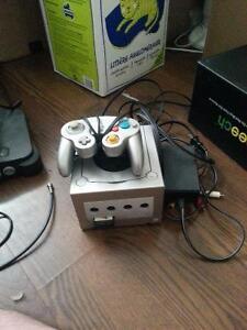 Nintendo gamecube with controller and zelda ocarina of time
