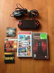 PSP with 2 movies and 3 games