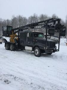 chargeuse a bois et camion