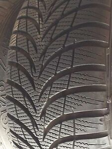 Like new 4 235/70/16 goodyear ultra grip snow tires