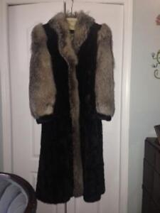 Full length black mink coat with grey fox trim and sleeves.