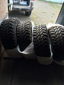 Almost new 33 inch mud/winter tires