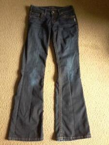Ladie's never even worn Silver flared jean's sz.3 asking $ 15.00
