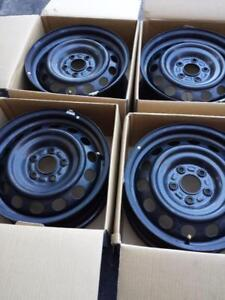 BRAND NEW TAKE OFF  MAZDA 3  FACTORY OEM 16 INCH STEEL RIM SET OF FOUR.