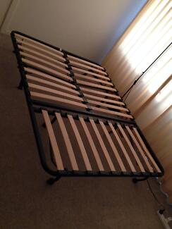 A Double-size Bed ( Mattress provided)