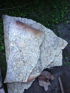 10 large pieces of broken polished granite