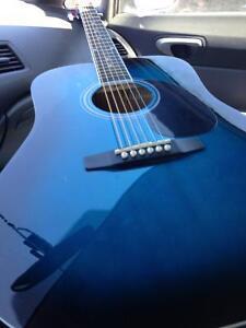 Wow , une superbe guitare bleu Madera acoustique + 6 accesoires