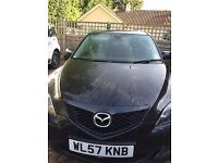 MAZDA 3 for sale, battered and bruised but good runner