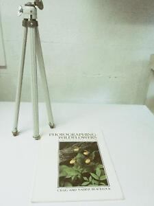 Camera tripod and book on how to take photos of wildflowers.