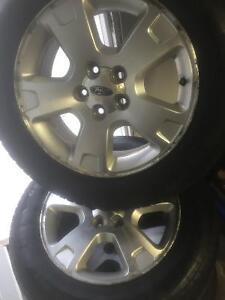 215/65/17 90% tread on Ford Alloy Rims