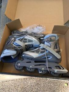 used once Ladies Roller Blades with protective gear