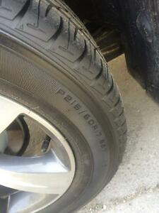 4 NEW (only 170 km's on them) FIRESTONE TIRES!! W/ WHEELS!!