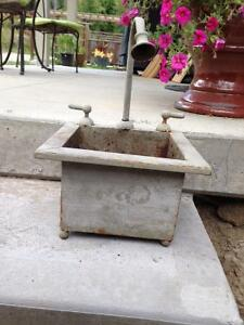 Cute Planter with ornamental water spout and taps