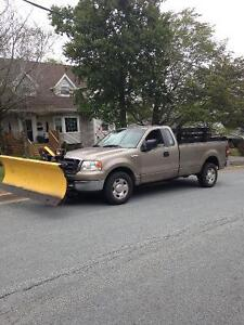 2004 Ford F-150 Super cab with fisher plow
