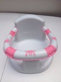 pink and white baby bath chair