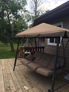 Covered porch swing