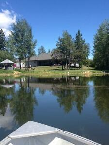 2 homes on 10ac with privately stocked lake. Kelowna