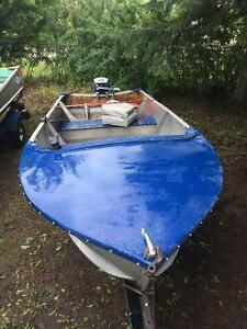 12' Aluminum with trailer and 15hp Evinrude