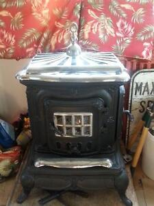 Antique wood burning Parlor Stove for sale.
