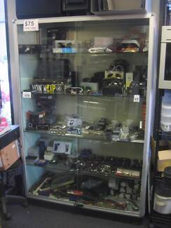LARGE GLASS DISPLAY CABINET. DOUBLE SLIDING DOORS