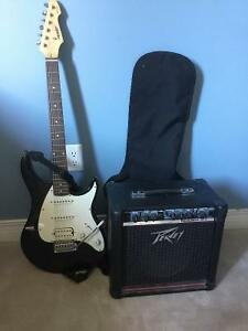 Peavey Raptor Plus electrical guitar with amplifier