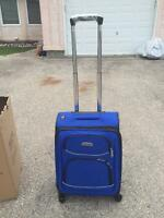 Brand New Delsey Spinner Luggage