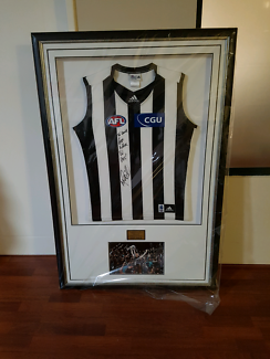Collingwood Football Club framed jumper and premiership photo