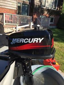 Like new Mercury 5.0HP 2-stroke outboard. Less the 5 hours on it