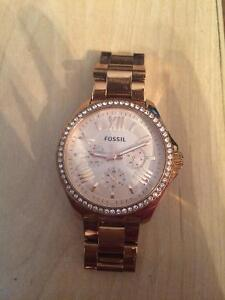 Rose Gold Fossil Watch with Roman Numerals