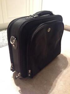 Laptop bag can also fit a PS3, PS4, and that kind of stuff.