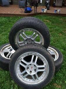 Set of 4 Hankook Ice Bear tires with stylist Voxx rims