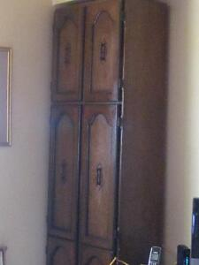FLOOR TO CEILING WOODEN PANTRY W. BRASS HANDLES