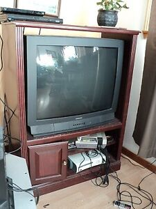 Large TV & stand $10. Must pick up. Heavy.