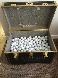 Footjoy Chest filled with assorted golf balls